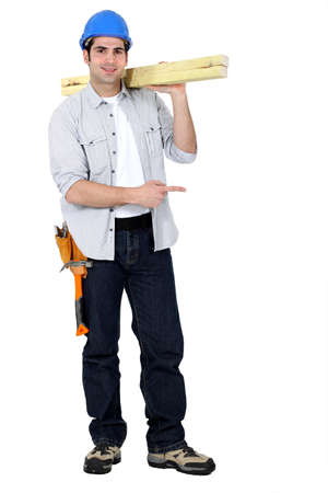 Carpenter standing on white background photo