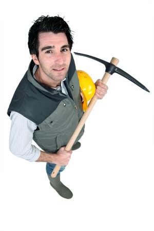 pickaxe: bricklayer holding pickaxe