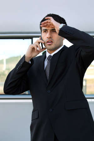 Disappointed man on the phone Stock Photo - 13621979