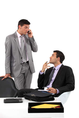 arrive: Businessmen patiently waiting for their client to arrive at a meeting