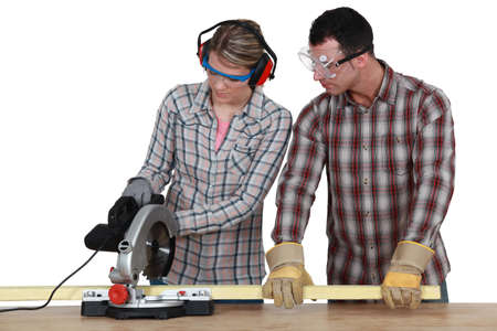 Apprentice with circular saw photo