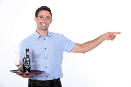 alcohol server: Waiter holding tray with beef bottle on it