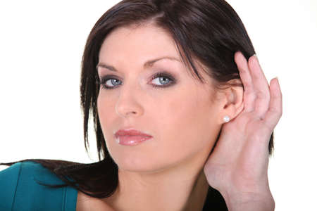 austere: Woman with her hand to her ear Stock Photo