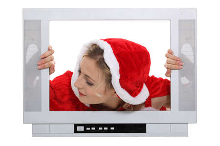 looking ahead: Woman with Christmas hat behind TV