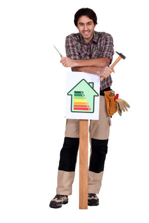 resourceful: Worker with an energy efficiency sign