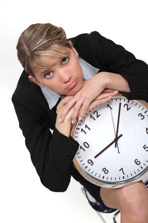 Businesswoman with a clock photo
