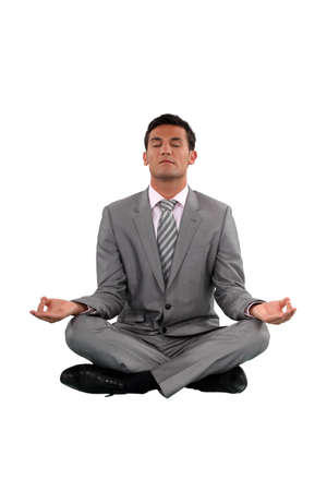 Businessman sat in lotus position photo
