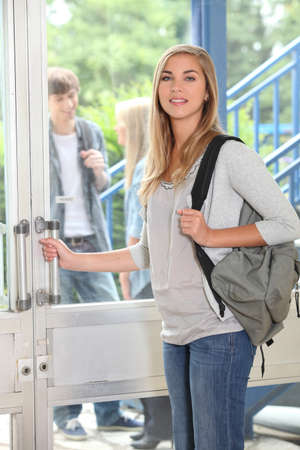 first day: Attractive female student at entrance