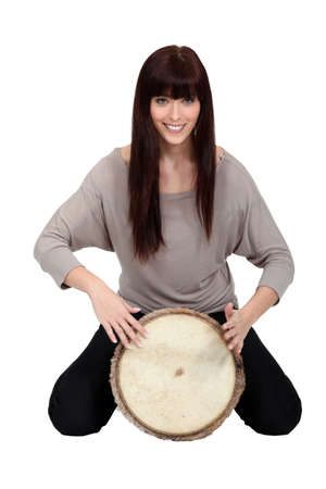 bongo drum: Brunette playing bongo drum