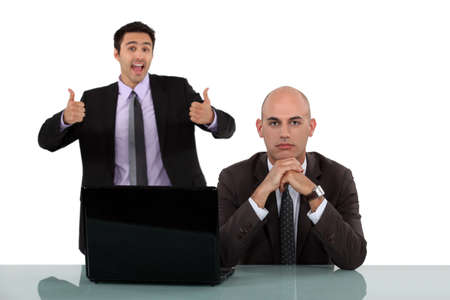 emotionless: Man rejoicing behind his long-faced colleague