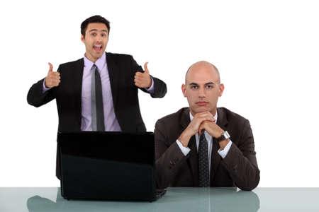 nonsense: Man rejoicing behind his long-faced colleague