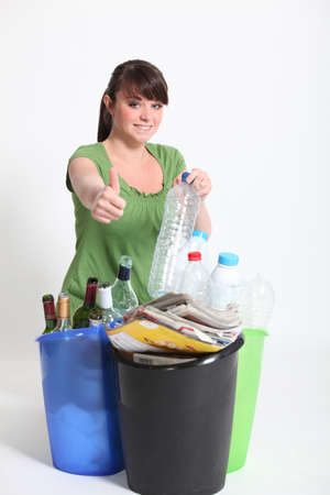 Brunette giving thumbs-up to recycling photo