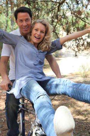 free riding: couple on a bike
