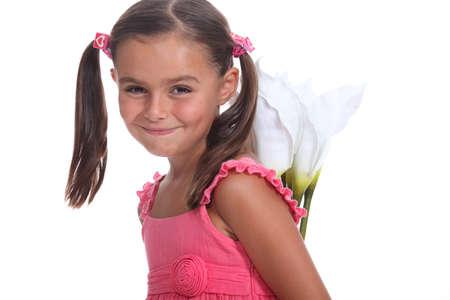 pigtails: Girl hiding flowers behind her back