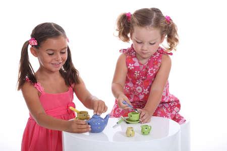 flatware: Little girls playing, studio shot