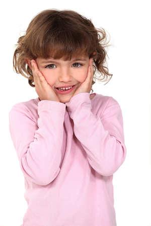 Surprised little girl photo