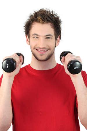 resistence: Man lifting weights Stock Photo