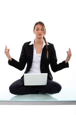 Businesswoman, sat in yoga position photo
