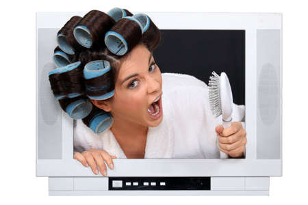 Woman in rollers inside a television photo