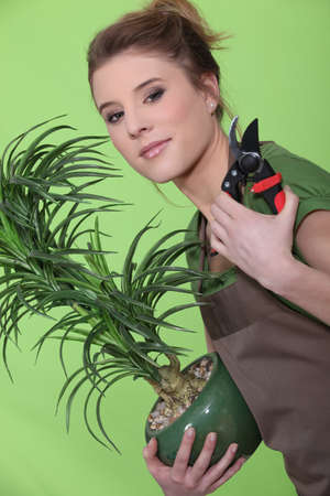 shear: Young woman tending to her plants