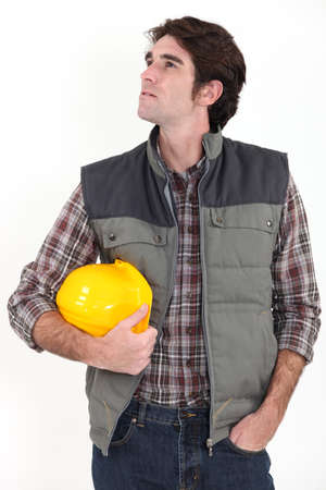 Construction worker looking out of frame photo