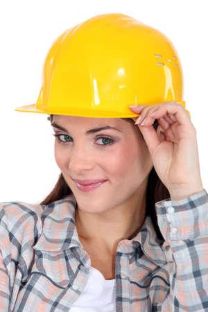 mischievous: brunette craftswoman looking mischievous Stock Photo