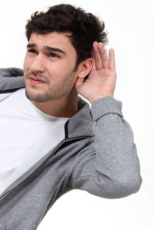 Casual man struggling to hear photo