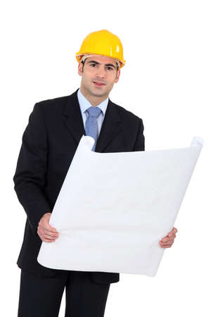 handsome young architect in suit with blueprints Stock Photo - 13621776