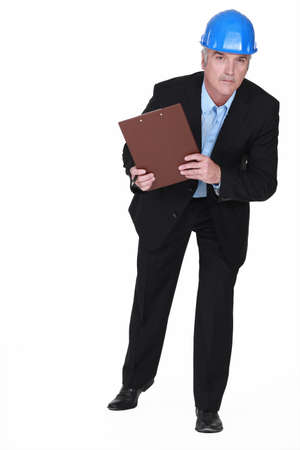 mature foreman holding clipboard photo