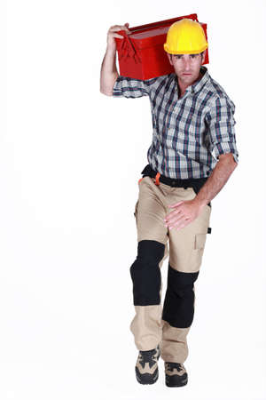 Worker running with a toolbox Stock Photo - 13621821