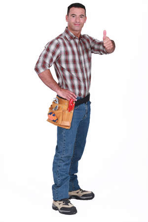 respectability: Handyman giving the thumb