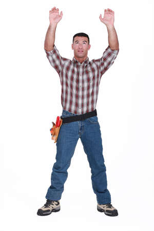 Tradesman reaching for an object photo
