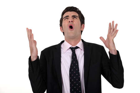 enrage: angry businessman screaming Stock Photo