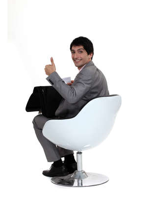 Smiling businessman giving the thumb Stock Photo - 13621686