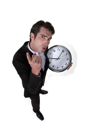 Angry boss holding clock Stock Photo - 13621704