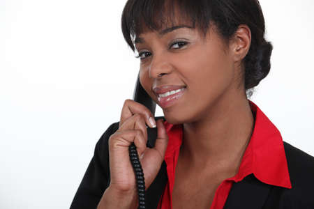 answering call: Receptionist answering a telephone