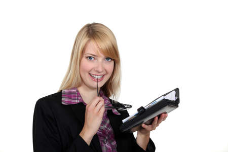 bewitch: Attractive woman looking at her agenda Stock Photo