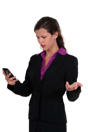 annoy: Angry woman reading a text message