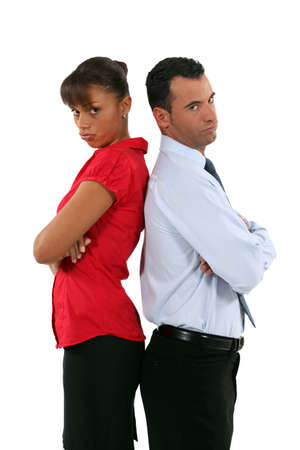 offend: couple standing back to back after quarrel Stock Photo