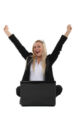 hooray: Triumphant businesswoman sitting at a laptop Stock Photo