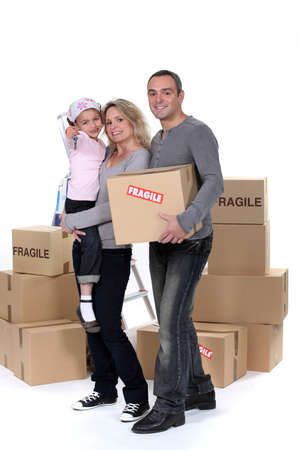 Young family with moving boxes Stock Photo - 13622058