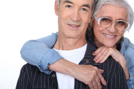 65 70 years: Elderly woman hugging her husband