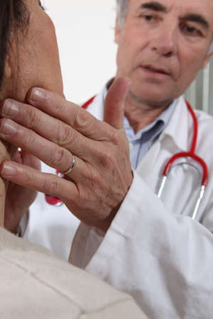 examining: Doctor examining his patient Stock Photo