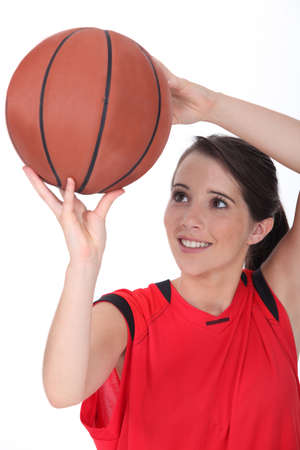 poised: Young female basketball player