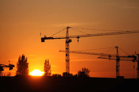 building contractor: Construction site at sunset Stock Photo