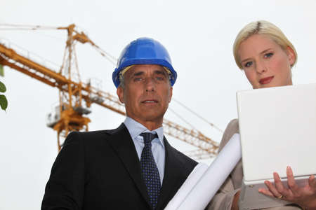 female architect with foreman in construction site photo