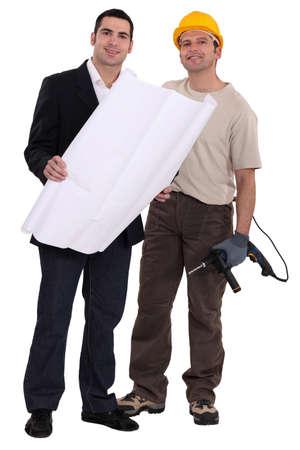 craftsman and businessman examining a blueprint Stock Photo - 13645557