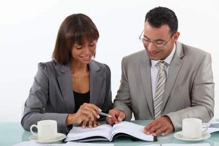 lapels: Man and woman studying a book together