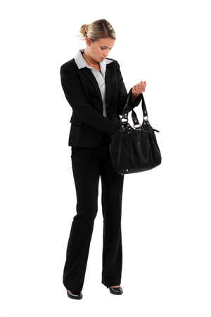 elegant woman in suit with bag photo