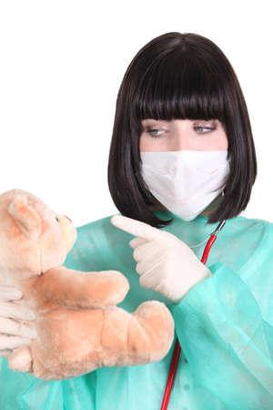 Doctor scolding a teddy bear photo